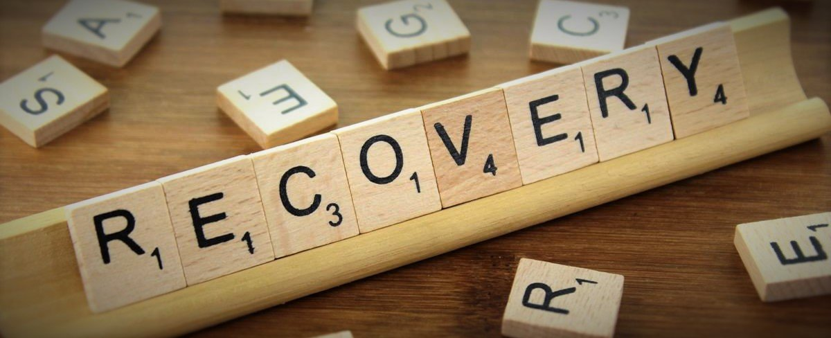 Recovery spelled in Scrabble letters
